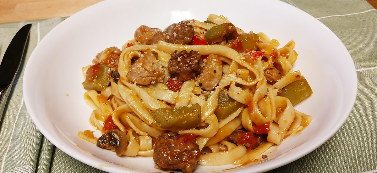 Italian Sausage & Chicken w/ Pepper Blend Over Pasta